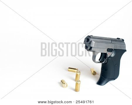 Five bullets and handgun with place for text