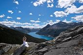 Mindfulness And Inner Peace. Meditation On Mountain Peak Above Blue Lake.  Scenic View Of Spray Lake poster