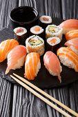 Постер, плакат: Japanese Menu Tasty Set Of Sushi With Salmon And Tuna California Rolls Maki Soy Sauce Closeup V
