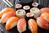 Freshly Prepared Sushi With Salmon And Tuna, California Rolls, Maki With Soy Sauce, Chopsticks Close poster