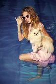 Pet, Companion, Friend, Friendship. Girl With Small Dog In Swimming Pool. Sensual Woman With Cute Sp poster