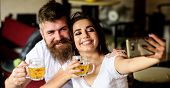 Couple In Love On Date Drinks Beer. Best Friends Or Lovers Drinking Beer In Pub. Man Bearded Hipster poster