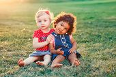 Group Portrait Of Two Cute Adorable Girls Toddlers Children Sitting Together. White Caucasian And La poster