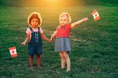 Happy Adorable Little Blond Caucasian And Hispanic Latin Girsl Smiling Holding Hands And Waving Cana poster