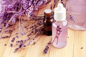 Skincare Lavender Refreshing Facial Toner In Bottle, Essential Oils, Pink Violet Blossom, Wooden Tab poster