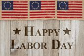 Happy Labor Day Greeting, Usa Patriotic Old Flag On A Weathered Wood Background With Text Happy Labo poster