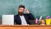 I Am Your New Teacher. Teacher Bearded Hipster With Eyeglasses Sit In Classroom Chalkboard Backgroun poster