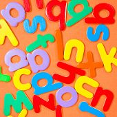 pic of mayhem  - Square background composed of colorful letters of the alphabet - JPG