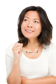 image of early 50s  - Thinking middle aged mature Asian woman looking up at copy space - JPG