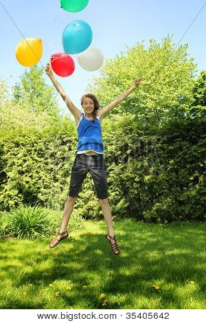 Teen Holding Baloons