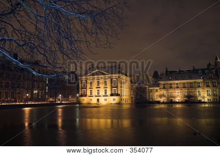 The Mauritshuis Seen From De Hofvijver In The Hague At Night, Covered By Snow.