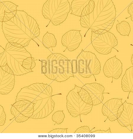 Seamless pattern of autumn leaves on the beige background