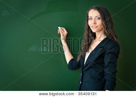 woman writing on blackboard