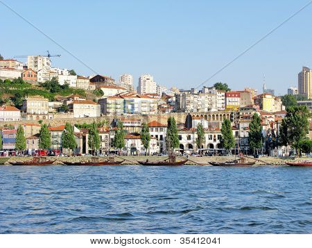 View Of Porto City And Wine Boats On River Douro In Portugal