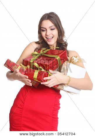 Happy brunette with boxed gifts in her hand
