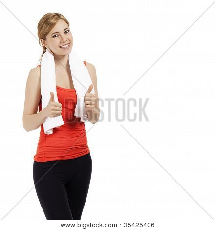 young beautiful fitness woman showing thumbs up