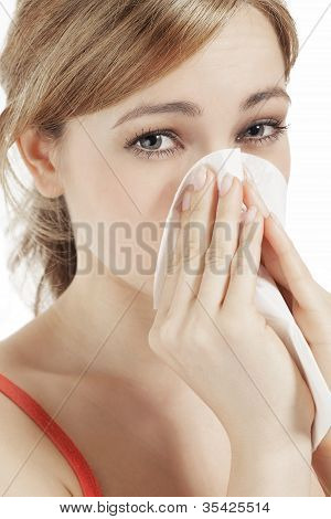 young blonde woman suffering on hay fever