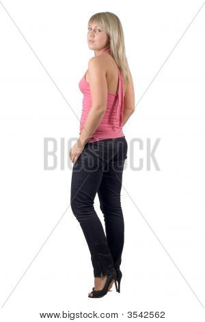 The Beautiful Young Woman In Black Jeans And Pink Jacket. Isolated