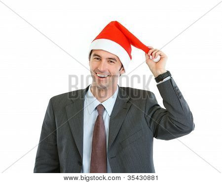 Portrait Of Smiling Businessman Playing With Santa's Hat