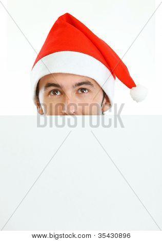 Male In Santa's Hat Hiding Behind Blank Billboard