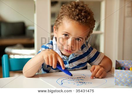 Charming Little Boy Busy Coloring At His Desk