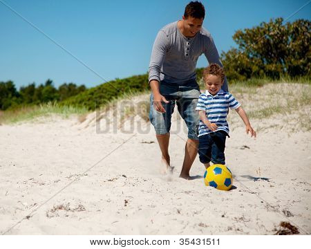 Father And Son Run After The Ball