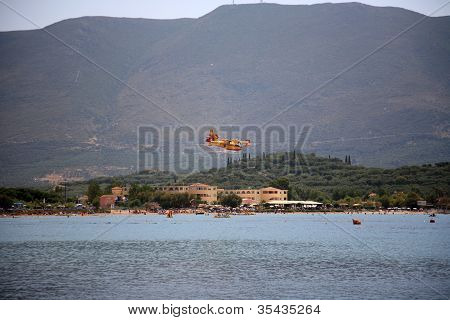 ZAKYNTHOS, GREECE- AUG 1: Canadair CL-415 or Bombardier 415 approaching the sea to take water during