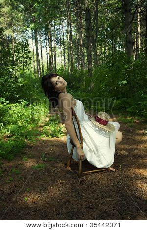 Lone Woman In Chair In Forest