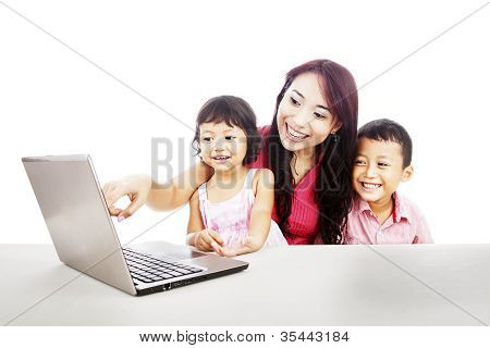 Happy Family With Ultrabook Laptop