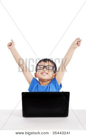 Successful Little Student With Laptop