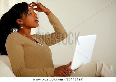 Tired Woman With Headache Browsing The Internet