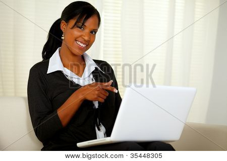 Woman On Black Suit Pointing To Laptop Screen
