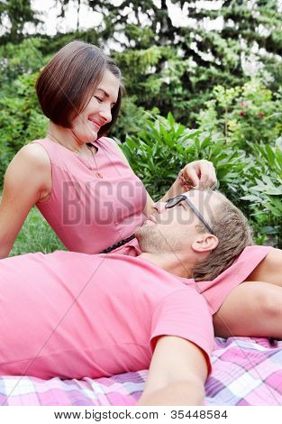 Woman Fondling Man on Picnic