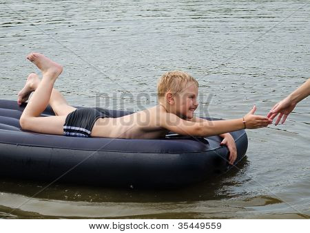The Child On An Inflatable Mattress