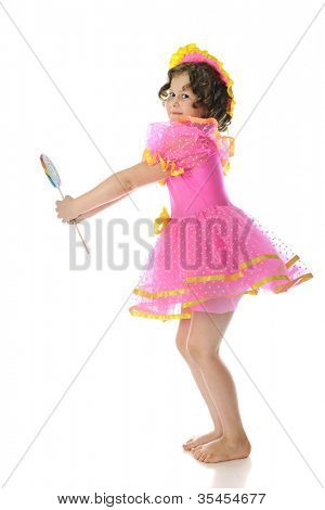 A young elementary girl playing Shirley Temple with her bright, frilly dress and giant lollipop.  On a white background.