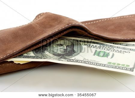 A purse with money. Isolated on a white background