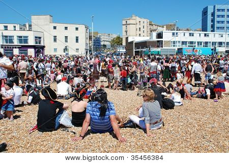 HASTINGS, ENGLAND - JULY 22: Pirates assemble on the beach in a successful attempt to regain the Guinness World Record for the largest gathering of pirates  on July 22, 2012 in Hastings, East Sussex.