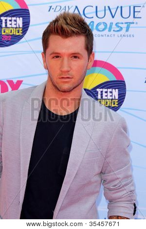 LOS ANGELES - JUL 22:  Travis Wall arriving at the 2012 Teen Choice Awards at Gibson Ampitheatre on July 22, 2012 in Los Angeles, CA