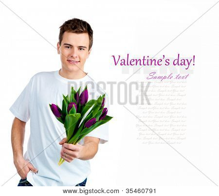 Cute young men with the flowers over white backgroung
