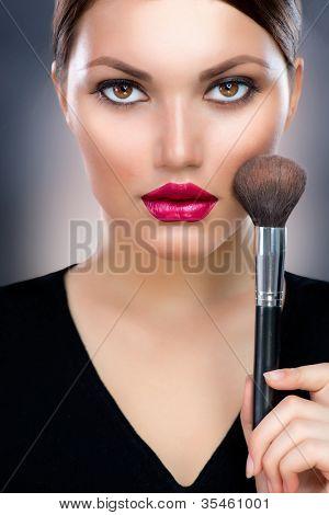 Makeup.Beautiful Woman Applying Make-up