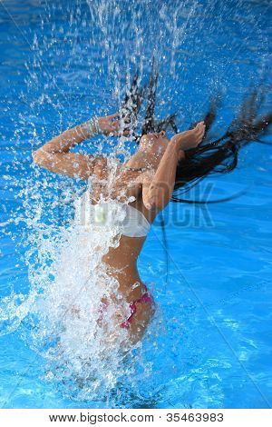 A beautiful woman relaxing in the pool