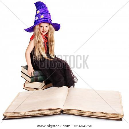 Witch wearing hat sitting on stack old book. Halloween.