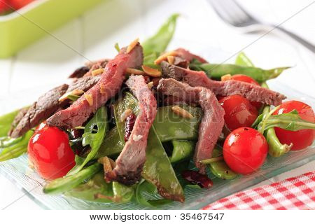 Strips of roast beef and sauteed vegetables