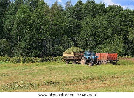 old tractor on summer field
