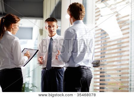 Business group quickly make changes in their pal before meeting with partners