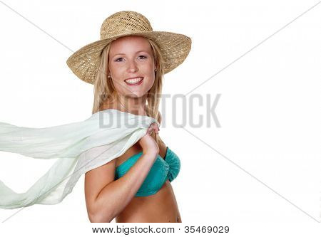 a pretty young woman wearing a straw hat in summer and bikini looking forward to the holidays.