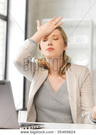 picture of stressed woman with laptop computer