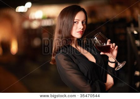 Beautiful girl with a glass of wine