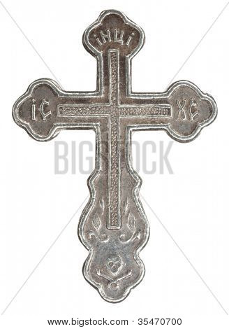 Silver cross with religious inscriptions in white background Super macro