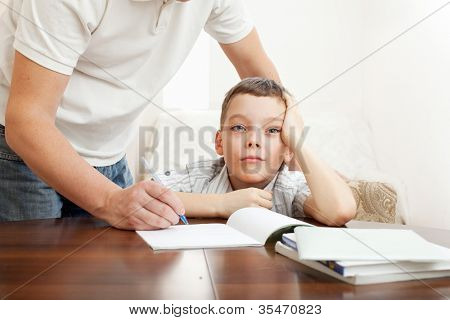 Father helping son do homework. Problems with homework